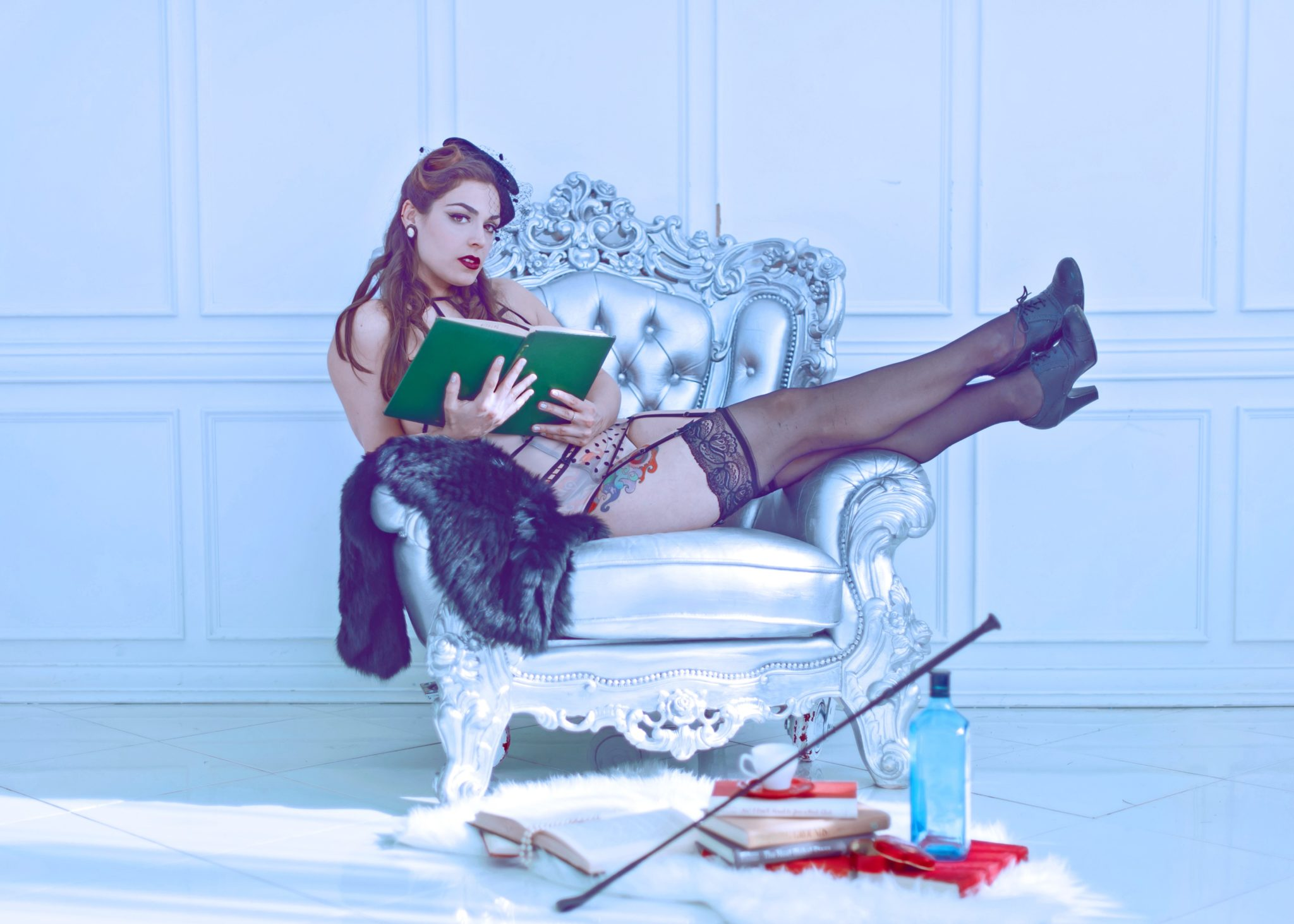 Mistress Pomf Reading in Black Stockings