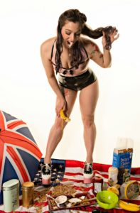 Mistress Pomf Shows Strong Muscular Legs While Spitting Milk