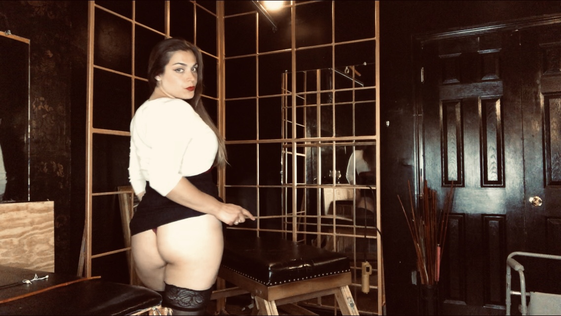 Dominatrix Mistress Pomf teases Her slave with an up-skirt flash.