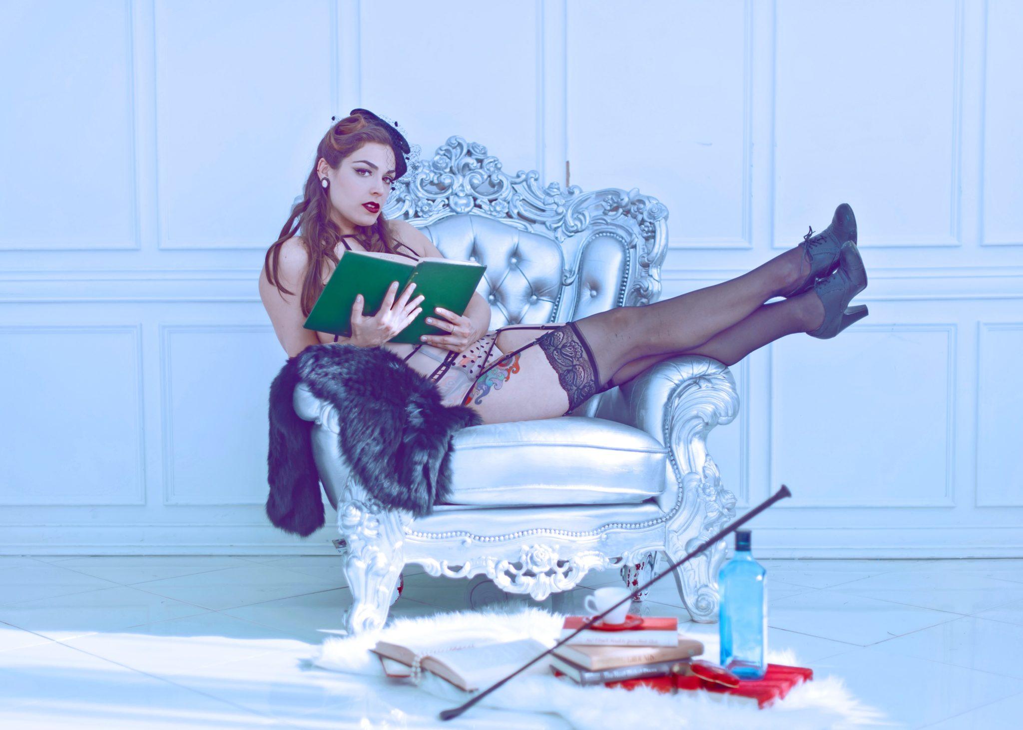 Mistress Pomf Reading in Black Stockings