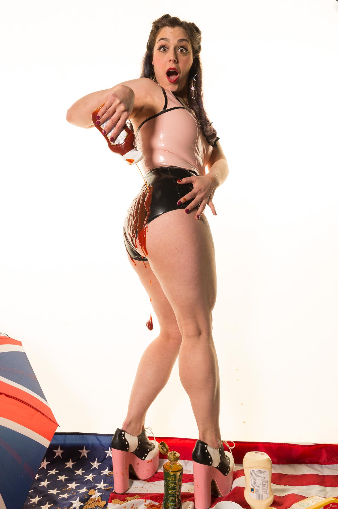 Mistress Sploshing Ketchup on Her Muscular Legs