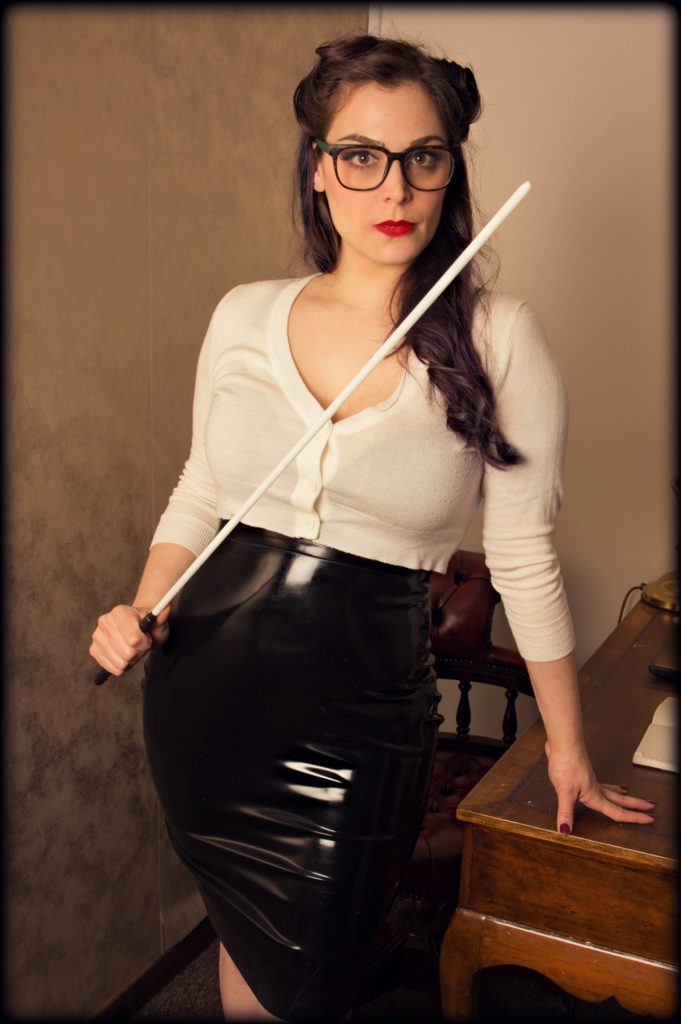Mistress Pomf holds her cane and warns you to behave in the UK's Manchester Chamber's schoolroom.