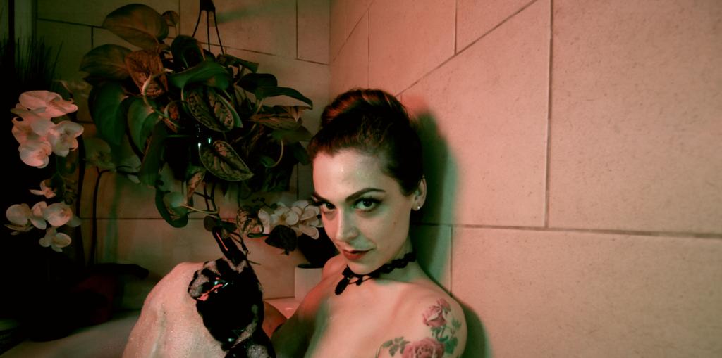 Mistress Pomf Wearing Latex Gloves in a Bubble Bath
