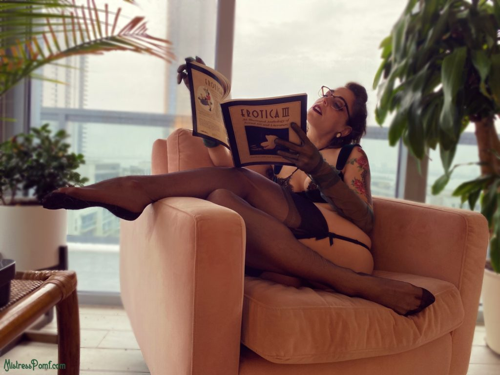 Florida Dominatrix Mistress Pomf roleplays as The Librarian surrounded by tropical plants as she reads erotica.
