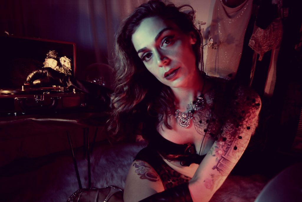 NYC Dominatrix Mistress Pomf wears shiny leather gloves