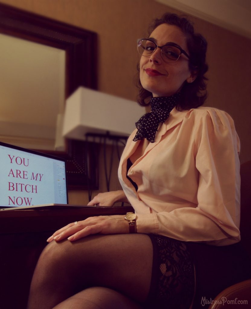NYC Dominatrix Mistress Pomf roleplays as the Secretary in an erotic blackmail fetish scene.